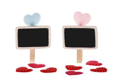 Detail of blue, pink and red dotted hearts and blackboards Stock Photography