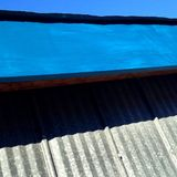 Detail of a blue rooftop Stock Photo