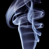 Blue Smoke on black background. Detail of Blue Smoke on black background Stock Image