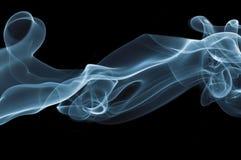 Smoke on black background. Detail of blue smoke on black background stock photography