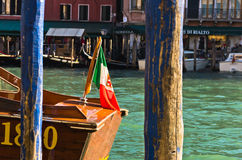 Detail of a boat with Italian flag at Grand canal in Venice Stock Images