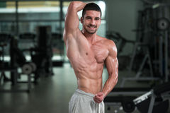 Detail Of A Bodybuilder Posing In The Gym Royalty Free Stock Images