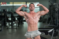 Detail Of A Bodybuilder Posing In The Gym Stock Images