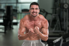 Detail Of A Bodybuilder Posing In The Gym Royalty Free Stock Image