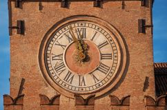 Bologna Clock Tower. Detail of Bologna Old Town Hall Clock Tower in Piazza Maggiore Major Square, built in the 15th century Stock Images