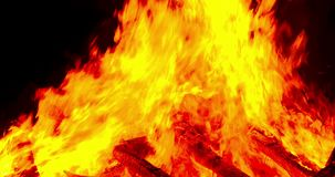 Detail of a bonfire. Zoom in. Close-up of a bonfire with the flames in motion.Three seconds of fixed plane, four seconds of Smooth camera movement: Zoom in and stock footage