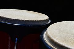 Detail of bongo drums macho and hembra, dark background. In spring morning sun stock photos