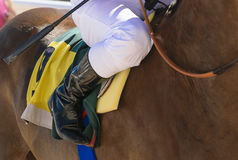 Detail of the boot of a jockey on his horse before the race Stock Images
