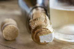 Detail of a bottle of bubbly white wine stock photos