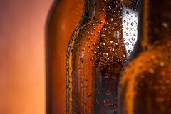 Detail of bottle of fresh beer with drops Stock Images