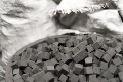 Detail of the bowl of charcoal cubes for hookah Royalty Free Stock Images