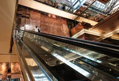 Escalator seen inside a large modern office block. stock image