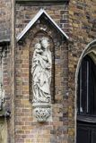 Detail of a brick cathedral in the Gothic style. Carved figure of the Virgin Mary on the side facade. St.Mary Magdalene Church.Wroclaw,Poland stock photos