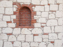 Detail of  brick portal in stone wall Royalty Free Stock Photo