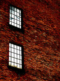Detail of brick wall with windows Royalty Free Stock Image