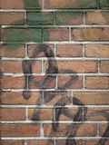 Detail of brick wall wth graffiti Royalty Free Stock Photos