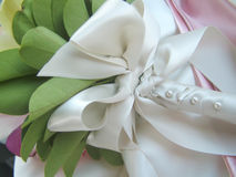 Detail of Bridal Bouquet. Detail of a bridal bouquet, white lace and pins royalty free stock photo