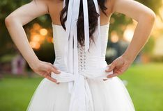 Detail of bridal dress. Detail of beautiful bridal dress in countryside Royalty Free Stock Photo