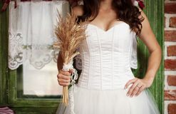 Detail of bridal dress. Detail of beautiful bridal dress in countryside Royalty Free Stock Photos