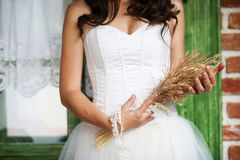 Detail of bridal dress. Detail of beautiful bridal dress in countryside Stock Photo