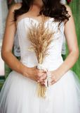 Detail of bridal dress. Detail of beautiful bridal dress in countryside Stock Image