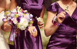 Detail and bride and bridesmaid with flowers Royalty Free Stock Photography