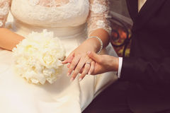 Detail of bride and groom holding hands. Wedding day Royalty Free Stock Image
