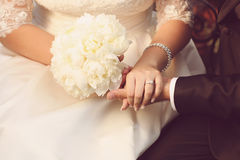 Detail of bride and groom holding hands. Wedding day Royalty Free Stock Photo