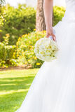 Detail of bride holds in hand a wedding bouquet of flowers in a garden Royalty Free Stock Photos