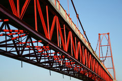 Detail of a bridge. Detail of a red iron bridge over blue sky Stock Photography