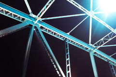 Detail of a bridge with road for cars at night. Many lights over Royalty Free Stock Images