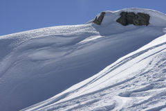 Snow waves and rock, San Pellegrino pass Royalty Free Stock Photography