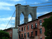 Detail of Brooklyn Bridge. From a Brooklyn street with old buildings stock image