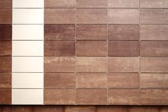 Brown and beige tile wall texture background Royalty Free Stock Photography