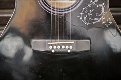 Detail of brown guitar placed on park bench Royalty Free Stock Image