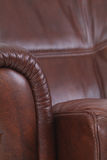 Detail of brown leather, luxury recliner Royalty Free Stock Image