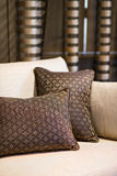 Detail of brown pillow on the beige sofa Stock Photography