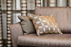 Detail of brown pillow on the brown sofa Royalty Free Stock Photos