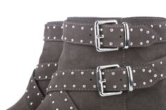 Detail of a brown studded ankle boots Royalty Free Stock Images