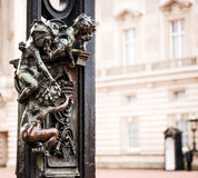 Detail of buckingham palace gate in london united kingdom royalty free stock images
