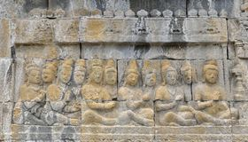 Detail of Buddhist carved relief in Borobudur temple. Detail of Buddhist carved relief in Borobudur temple in Yogyakarta, Java, Indonesia Royalty Free Stock Photos
