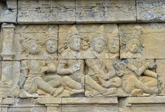 Detail of Buddhist carved relief in Borobudur temple. Detail of Buddhist carved relief in Borobudur temple in Yogyakarta, Java, Indonesia Stock Image