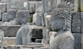 Detail of Buddhist carved relief in Borobudur temple in Yogyakar Royalty Free Stock Image