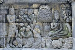 Detail of Buddhist carved relief in Borobudur temple in Yogyakar. Ta, Java, Indonesia Royalty Free Stock Photos