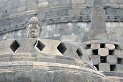 Detail of Buddhist carved relief in Borobudur temple in Yogyakar Royalty Free Stock Photo