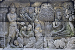 Detail of Buddhist carved relief in Borobudur temple Royalty Free Stock Image
