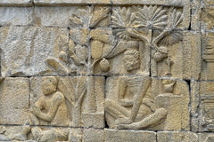 Detail of Buddhist carved relief in Borobudur temple Stock Images