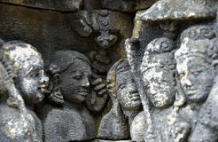 Detail of Buddhist carved relief in Borobudur temple Royalty Free Stock Photography