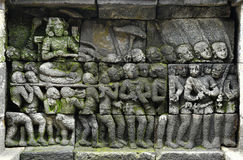 Detail of Buddhist carved relief in Borobudur temple Stock Photo