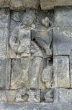 Detail of Buddhist carved relief in Borobudur temple Royalty Free Stock Photos